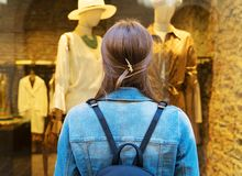 Female tourist looking at the shop window royalty free stock photo
