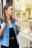 Female tourist looking at the shop window stock image