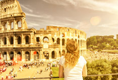 The female tourist looks at the Colosseum in Rome Stock Image
