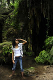 Female tourist lost in the jungle. Female tourist lost in a tropical forest stock photo