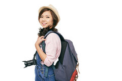 Female tourist. Lovely female tourist with backpack, isolated on white royalty free stock images