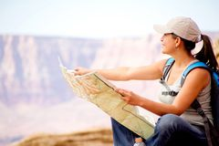 Female tourist with a map Stock Images