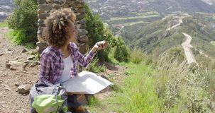 Female tourist with map and compass stock video footage