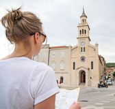 Female tourist with map. royalty free stock photos