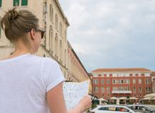 Female tourist with map. stock photography