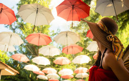 Female tourist marvels at baldachin of umbrellas Stock Image