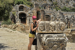 Female tourist near the ruins of ancient buildings Royalty Free Stock Images