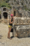 Female tourist near the ruins of ancient buildings Stock Photos