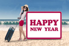 Female tourist with new year board Royalty Free Stock Image