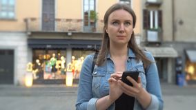 Female tourist in the old city with mobile phone. Female tourist in the old city walking with mobile phone stock video