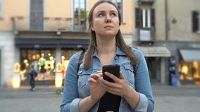 Female tourist in the old city with mobile phone. Female tourist in the old city walking with mobile phone stock footage