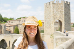 Female tourist with old medieval stone bridge with gate Stock Image