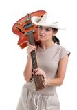 Female tourist with orange electric guitar Royalty Free Stock Image