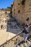 Female tourist overlooks Herodian Street in Old City Jerusalem. Alongside Western Wall of ancient Temple Mount stock image