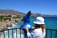Female tourist and panorama binoculars Royalty Free Stock Photos
