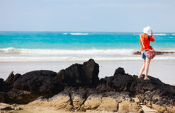 Female tourist photographing beach Royalty Free Stock Photography