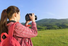 Female tourist photographing on camera Stock Images