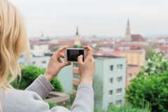 Female tourist photographing view Cluj Napoca. Traveling Romania Stock Photos