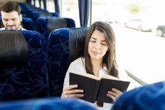 The Bus Is A Great Place To Catch Up On Some Reading stock image