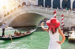 Female tourist aking pictures from the Rialto Bridge in Venice, Italy Royalty Free Stock Images