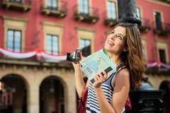 Female tourist sightseeing and holding guide map Royalty Free Stock Photos