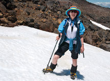 Female tourist on snowy slope. Smiling female tourist on slopes of Mount Ruapehu, active volcano located on North Island of New Zealand - popular ski resort Stock Photography