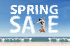 Female tourist with spring sale text Royalty Free Stock Photography