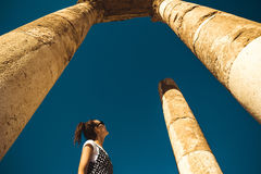 Female tourist stand between columns exploring Hercules Temple remains on Amman Citadel hill. Ancient ruins. Travel concept. Touri. Photo of the Female tourist Stock Photos