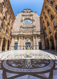 Female tourist standing in the courtyard of the monastery of Montserrat. Royalty Free Stock Images
