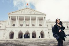 Female tourist standing in front of the Parliament of Portugal, Assembly of the Republic. Beautiful architecture of Assembleia da República.Walking woman royalty free stock photos