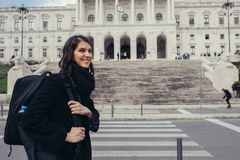 Female tourist standing in front of the Parliament of Portugal, Assembly of the Republic. Beautiful architecture of Assembleia da República.Walking woman stock image