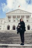 Female tourist standing in front of the Parliament of Portugal, Assembly of the Republic. Beautiful architecture of Assembleia da República.Walking woman royalty free stock images