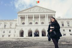 Female tourist standing in front of the Parliament of Portugal, Assembly of the Republic. Beautiful architecture of Assembleia da República.Walking woman stock photos