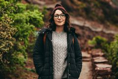 Female tourist standing on hill steps stock photos