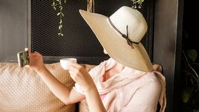 Female tourist with straw hat taking selfie Royalty Free Stock Photos