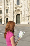 Female tourist studying a map Stock Images