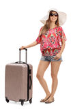 Female tourist with a suitcase. Full length portrait of a female tourist with a suitcase isolated on white background Royalty Free Stock Image