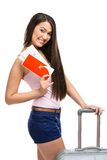 Female tourist with suitcase and ticket Royalty Free Stock Image