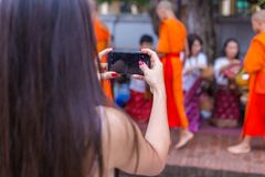 A female tourist takes picture of people in traditional clothes royalty free stock photos