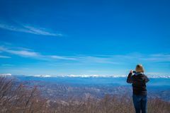 Girl taking pictures in the Lovcen National Park stock image