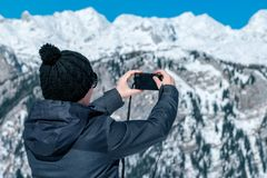 Female tourist taking picture of mountain landscape with compact Stock Images