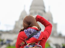Female tourist taking photo of Sacre-Coeur cathedral Stock Photography