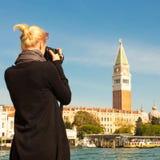 Female tourist taking photo of Venice. Stock Images