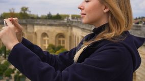 Female tourist taking photo of Versailles garden by smartphone. Happy female tourist taking photo of Versailles garden by smartphone. Concept of visiting France stock video footage