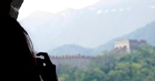 Female tourist taking a photograph of the Great Wall of China stock photo
