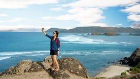 Female tourist taking photos on Merese hill stock image