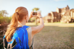 Female tourist taking picture of Angkor Wat temple, Cambodia Royalty Free Stock Image