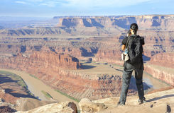 Female tourist taking pictures of a canyon landscape. Stock Image