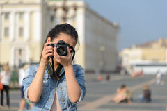Female tourist taking pictures in city Stock Photography