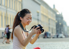 Female tourist taking pictures in city Royalty Free Stock Photo